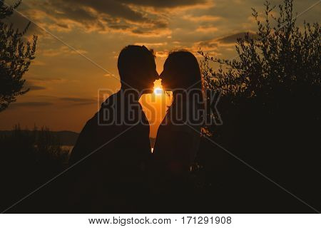 Сouple Kissing On The Sunset At The Garda Lake, Italy.