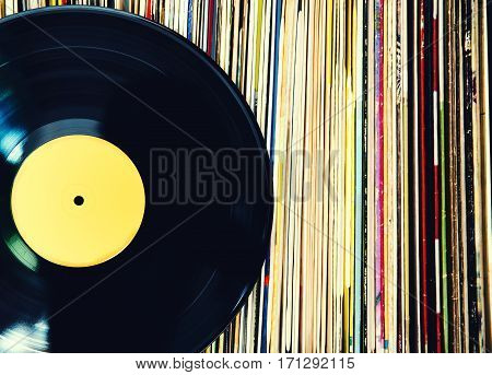 Old vinyl record and a collection of albums.