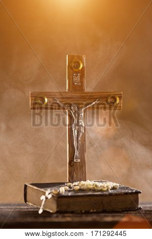Close-up of wooden Christian cross. Christianity concept.