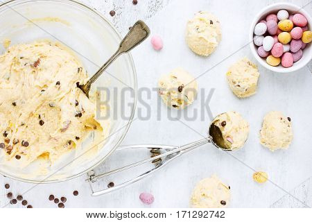 Cooking Easter cookies with crushed chocolate candy eggs chocolate drops and sprinkling sugar recipe step by step