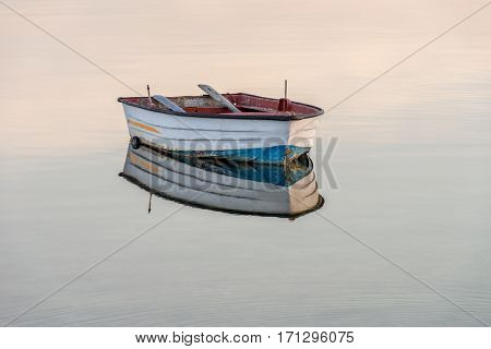 wooden fishing boat on a background of water