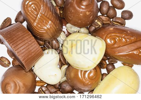 Close Up Of Assortment Of Dark White And Milk Chocolate Mixed With Coffee Beans On A White Background