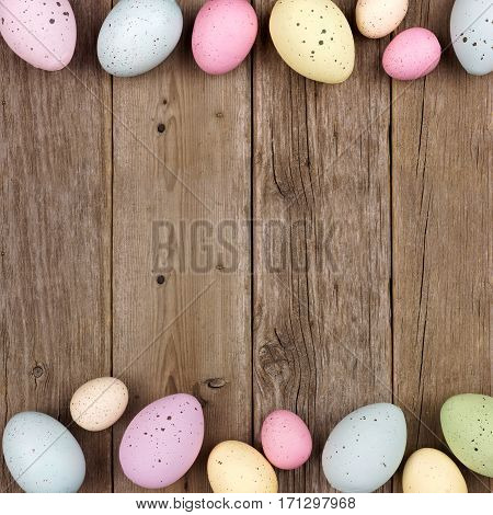 Pastel Speckled Easter Egg Double Border Against A Rustic Wood Background