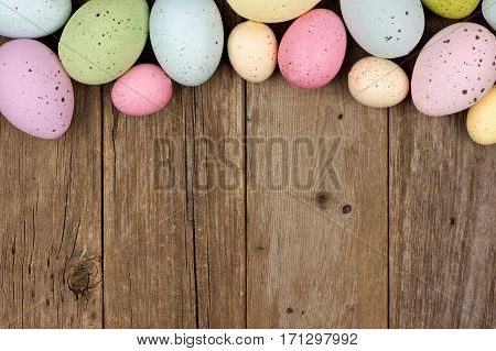 Pastel Speckled Easter Egg Top Border Against A Rustic Wood Background