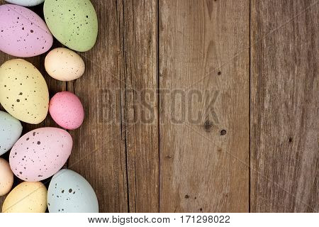 Pastel Speckled Easter Egg Side Border Against A Rustic Wood Background