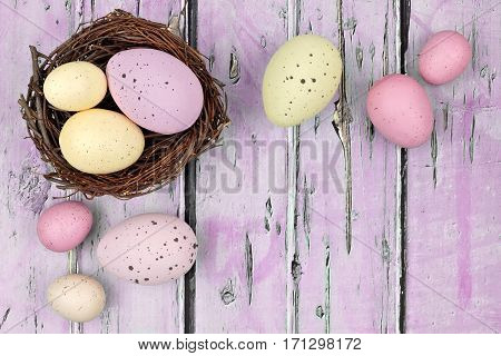 Springtime Nest With Speckled Easter Eggs Against A Rustic Purple Wood Background