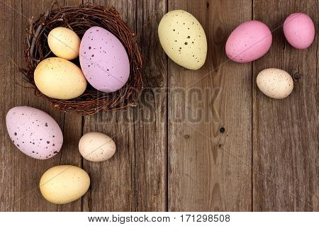 Springtime Nest With Speckled Easter Eggs Against A Rustic Wood Background