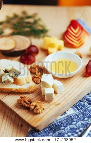 plate with blue cheese Dor, parmesan cheese, Brie, Camembert and Roquefort