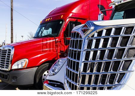 Indianapolis - Circa February 2017: Navistar International and Freightliner Semi Tractor Trailer Trucks Lined up for Sale III