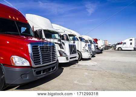 Indianapolis - Circa February 2017: Colorful Semi Tractor Trailer Trucks Lined up for Sale V