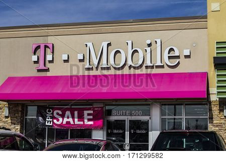 Indianapolis - Circa February 2017: T-Mobile Retail Wireless Store. Deutsche Telekom is T-Mobile's majority shareholder VII