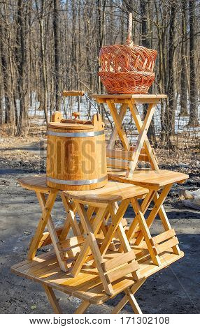 Trade of Handicrafts in the street in the spring. Woven baskets, rattan furniture and oak products for sauna