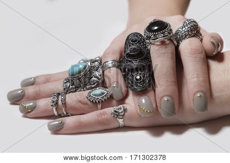 Various Silver Rock Rings With Nice Manicured Fingernails.