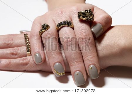 Two Beautiful Rings With Nice Manicured Fingernails.