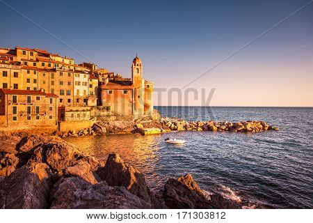 Tellaro rocks and old village on the sea. Church and houses. Five lands Cinque Terre Liguria Italy Europe.