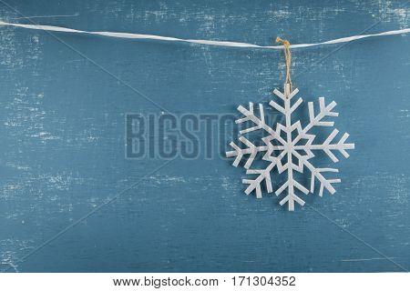 Felt Snowflake Ornament Hangs From Ribbon