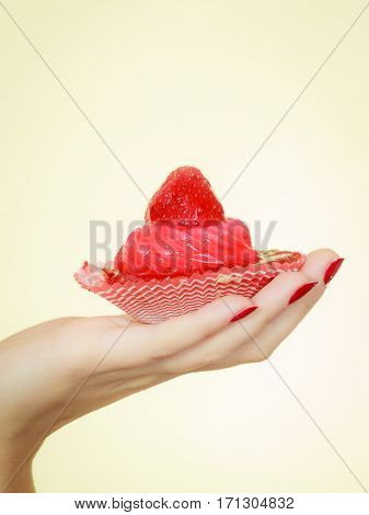 Woman Holding Sweet Delicious Cupcake