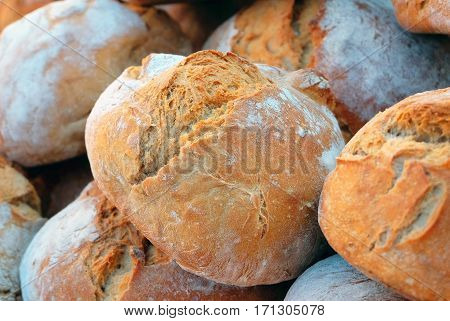 Loaf bread. Many loaves of bread. Background. Loaf bread on bakery stall.