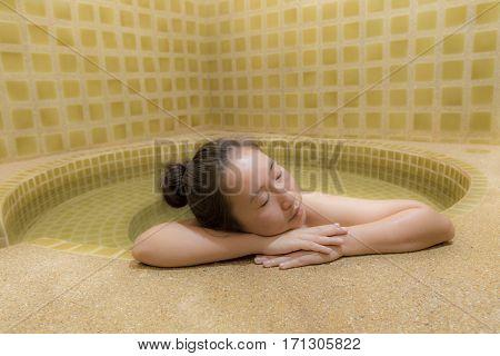 Woman Enjoy Onsen In Japan,woman Relaxing In Hot Springs