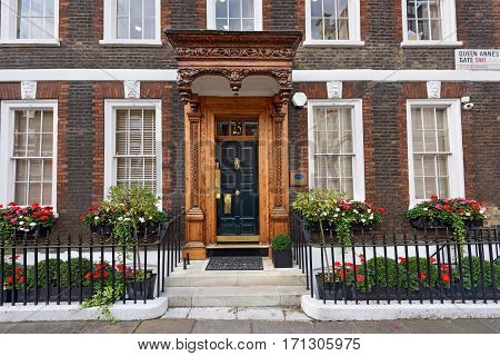 LONDON/ UK - SEPTEMBER 1. The carved porch of the Noon Group Building in Queen Anne's Gate on September 1, 2016. Westminster, London, UK