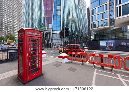 LONDON/ ENGLAND - SEPTEMBER 1. The old telephone box and the new Nova Victoria Building in the City of Westminster in central London on September 1, 2016. England.
