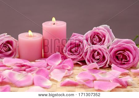 Set of Pink rose with candle and petals on mat