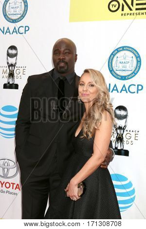 LOS ANGELES - FEB 11:  Mike Colter, Iva Colter at the 48th NAACP Image Awards Arrivals at Pasadena Civic Auditorium on February 11, 2017 in Pasadena, CA