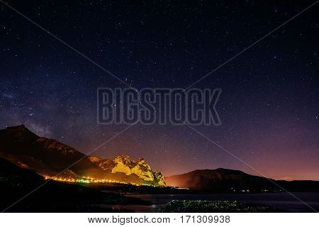 Starry Sky over the city by the sea. Sicily. Italy Europe