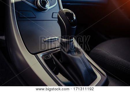 Modern car interior dashboard and steering wheel.