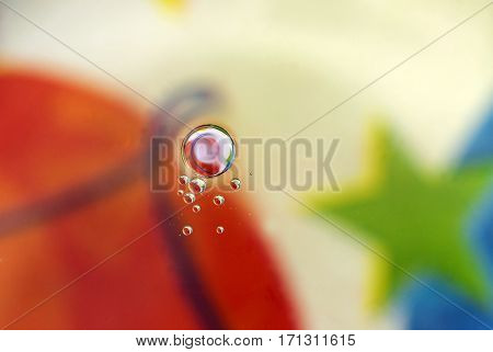 Oil in water forming circles abstract background