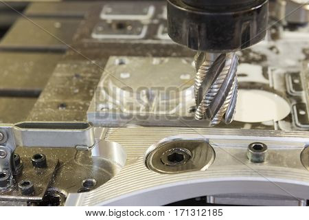 Close-up of the rough cutting tool attached the CNC machining center with the sample part