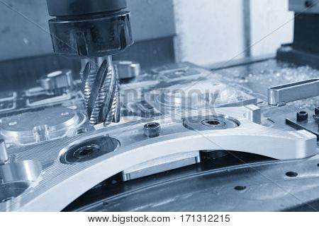 The CNC machining center attach the rough cutting tool with the light blue scene