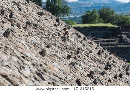 Rocks sticking out on the of the Pyramid of the Sun in San Joan Teotihuacan near Mexico City in Mexico.