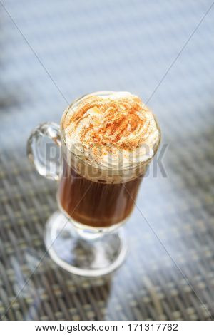 Irish Coffee In An Outdoor Bar. Concept Of St Patrick Holiday. Holiday Background