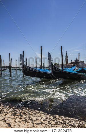 Gondolas and San Giorgio maggiore, view from San Marco square, in Venice, Italy