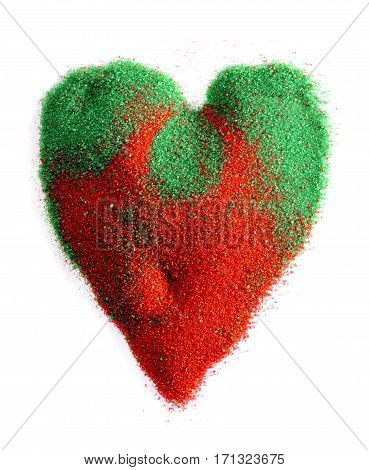 Symbol of heart in the sand of red and green on a white background