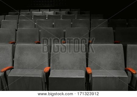 vintage seat in movie theater empty auditorium black and white tone
