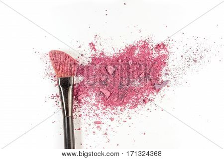 Makeup brush on white background, with vibrant traces of powder and blush. A horizontal template for a makeup artist's business card or flyer design, with plenty of copy space