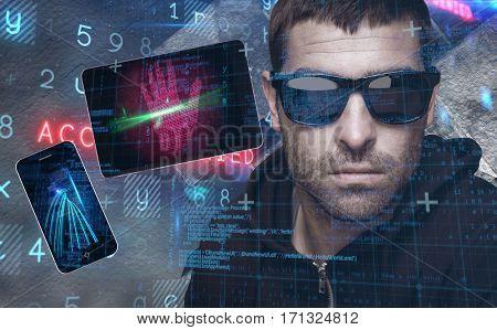 Portrait of burglar wearing sunglasses against virus background