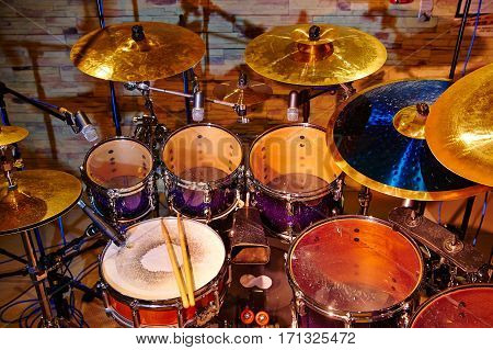 drum set with two wooden drumsticks on it