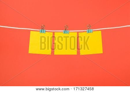 Blank Yellow Paper Notes Hanging On Clothesline