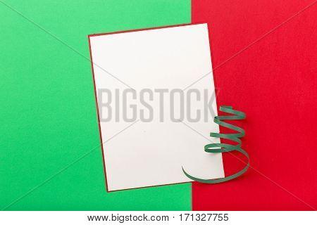 Blank card on a colorful background top view.