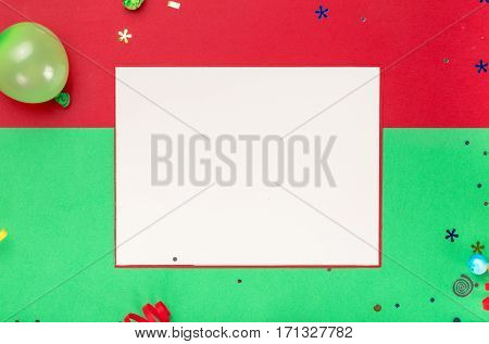 Blank card with streamers confetti and balloon on a colorful background top view. Colorful celebration background