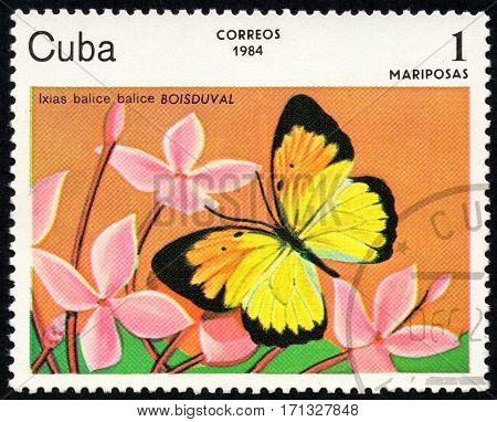 UKRAINE - CIRCA 2017: A stamp printed in Cuba shows image of a butterfly Ixias balice balice BOISDUVAL close-up circa 1984