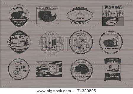 Vector illustration of Set vintage camping and outdoor adventure emblems, logos and badges. Camping equipment. Camp trailer in the forest on wood background.