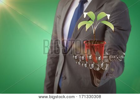Digitally generated image of potted plant against green vignette, 3d