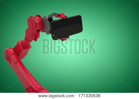 Digital generated image of red robot holding smart phone against green vignette 3d