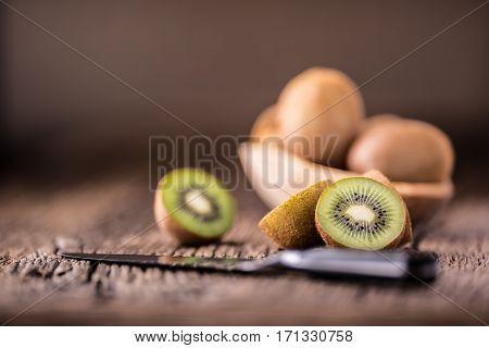 Kiwi Fruit. Several kiwi fruit on oak wooden surface.