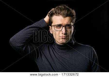 Smart Guy With Glasses Thinking About An Idea