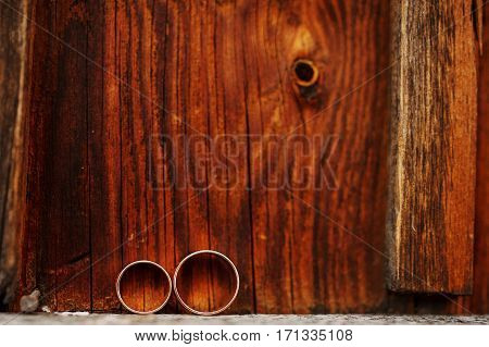 Wedding Rings On Wooden Background. Love Concept Of Marriage.
